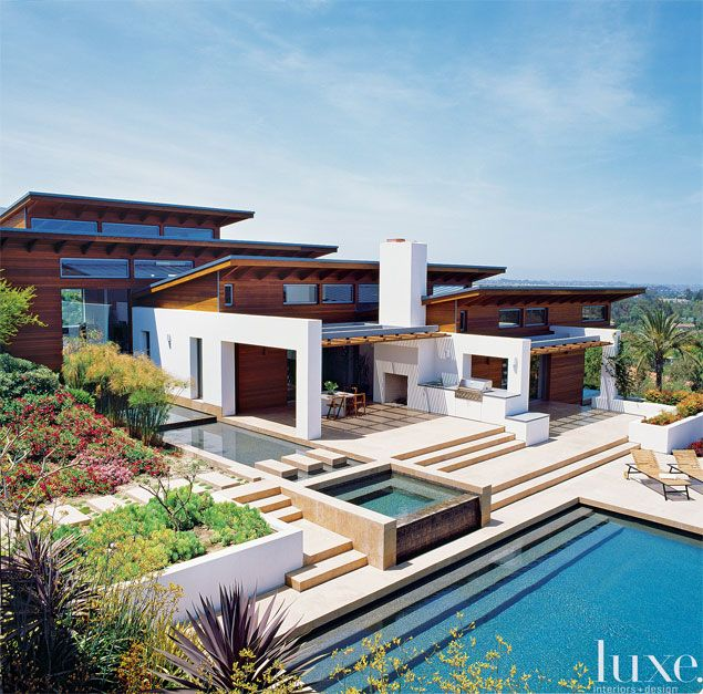 Liberal use of cedar on the exterior, where it's complemented by cream-colored stucco, further connects this sprawling, 10,500-square-foot modern home to it's environment.