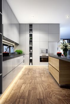 Modern and stylish kitchen design with clean white cabinets and a wooden kitchen island.