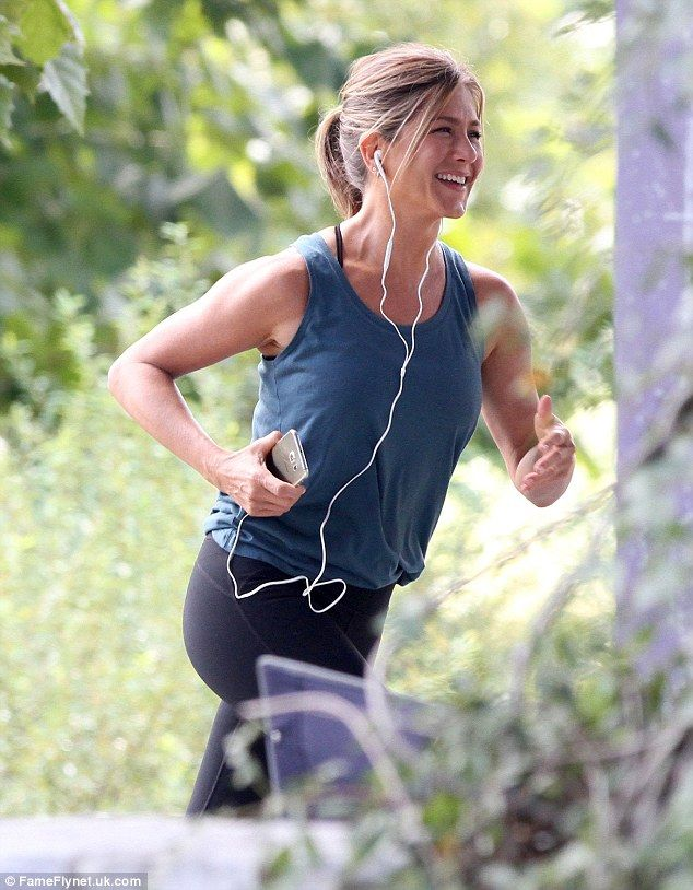 In-vested in her fitness: Jennifer Aniston was spotted yet again on the Atlanta set of the film working up a sweat in a Fabletics Pryor Tank, Lima Capri, and Dash Sports Bra on Friday