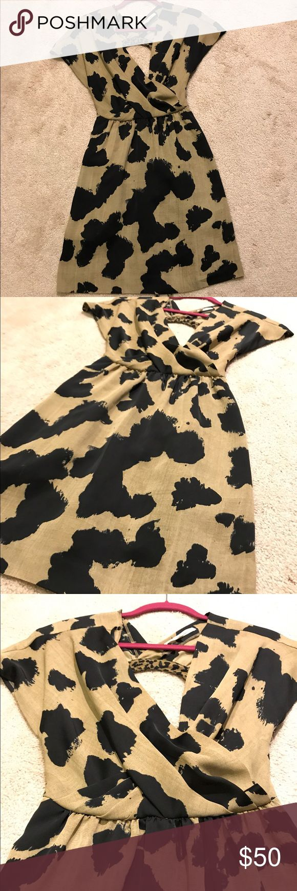 Rachel Roy Animal Print Short Dress Size XXS Rachel Roy, black and beige animal print dress. Size XXS, short dress. Keyhole back and apron style tie back. In excellent, like new condition! Rachel Roy Dresses Mini