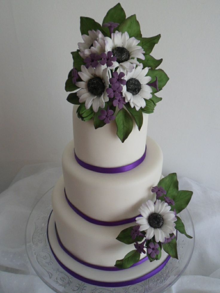 3 tier stacked wedding cake with sugar flower sprays blue eyed daises purple filler flowers. Black Bedroom Furniture Sets. Home Design Ideas