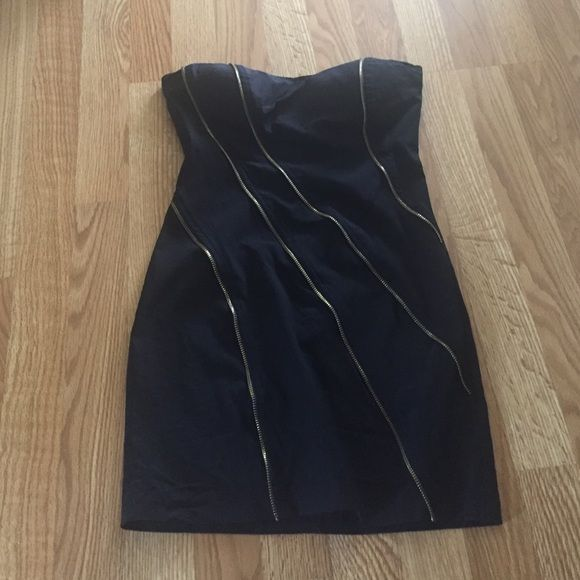 SPRING CLEAN OUT Black mini dress Black mini dress with fake zipper designs in front. Worn. But in good condition. 65% cotton, 32% nylon, 3% spandex. Looks small, but is a little stretchy. SALE UNTIL WEDNESDAY 3/23/16 WILL GO BACK TO $8 Dresses Strapless