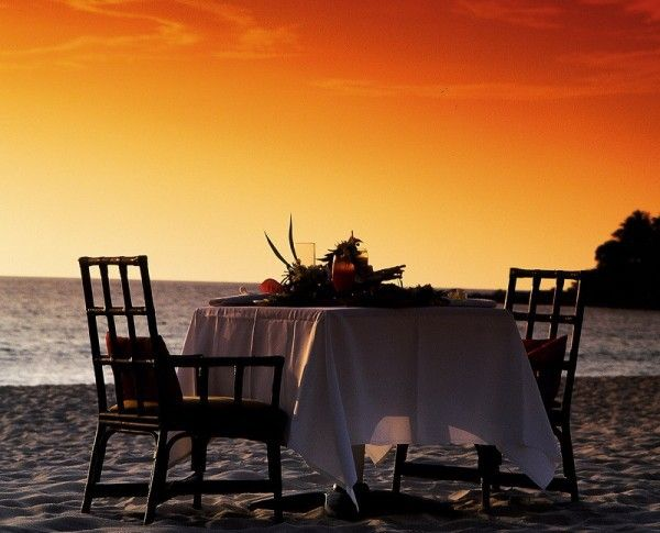 Picturesque romantic location inspired candlelight sunset sea sand flowers mussels idea Orange sky