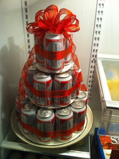 Beer cake. Great for bday presents. All you need is firm cardboard cut into 3 square (big, medium, small) to use as the bases, approximately 24 cans (can make a smaller cake with less cans), and a bow!