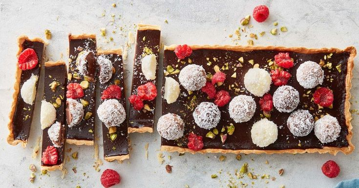 Take a few shortcuts with this rich, chocolate tart topped with raspberry and pistachio coated Lindt balls.
