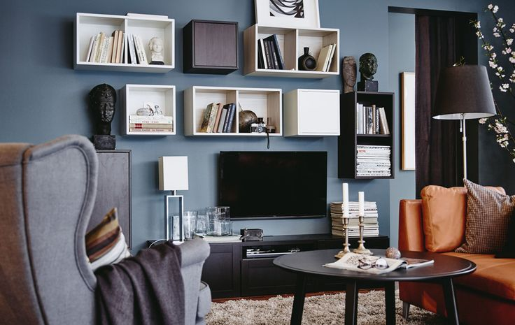 Disguise your TV by surrounding it with some square shaped storage units. These ones can be fixed and combined any way you choose.