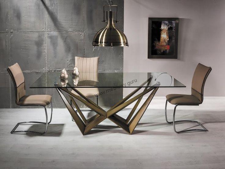 Nowoczesny stół Aston to futurystyczne połączenie szkła hartowanego będącego prostokątnym blatem ze stelażem wykonanym z MDF w kolorze złoto miedzianym.