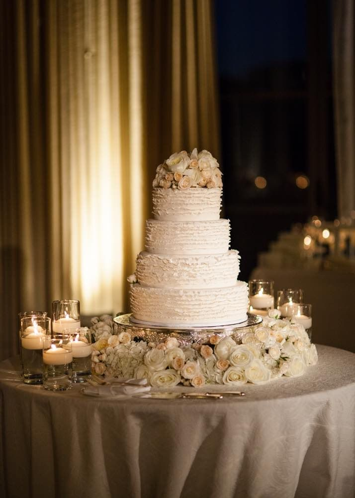 delicious and classy wedding cake table; photo: Samuel Lippke Studios