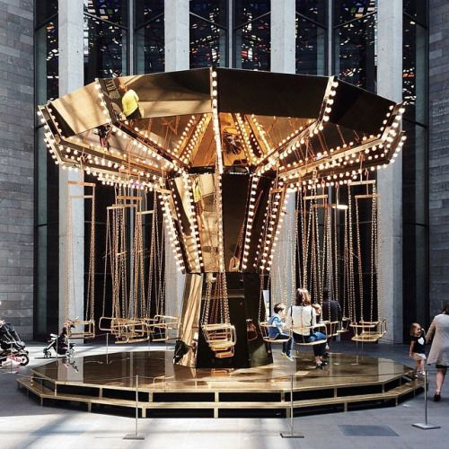 Golden mirror carousel by Carsten Höller: