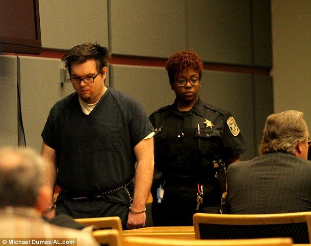 Murderer: John DeBlase walks to his seat in a courtroom in Mobile, Alabama, before being sentenced to death for torturing and killing his two young children