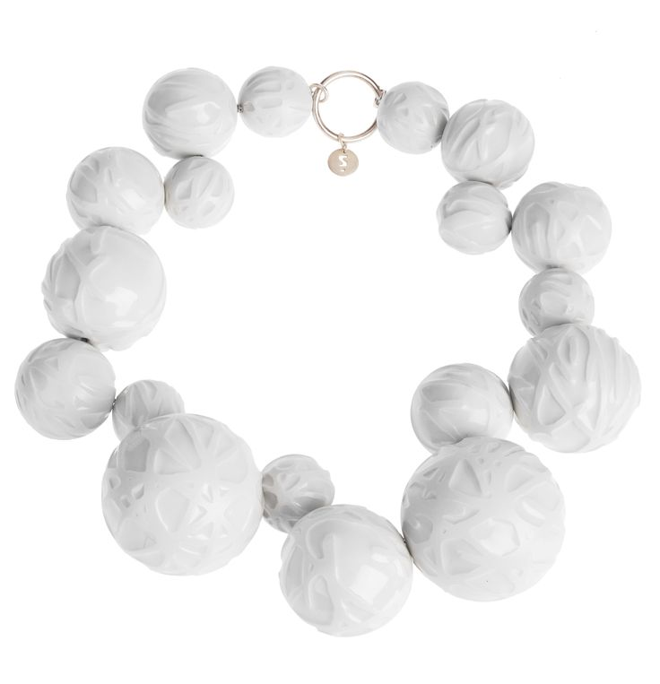 Short necklace made of  porcelain balls and silver from SU-MIN collection.  The white porcelain ball was designed by famous polish artist Bogdan Kosak. Every single piece is unique. The irregular lines are artist interpretation of a long grass in his home village SUMIN.  This product is handmade in Poland.