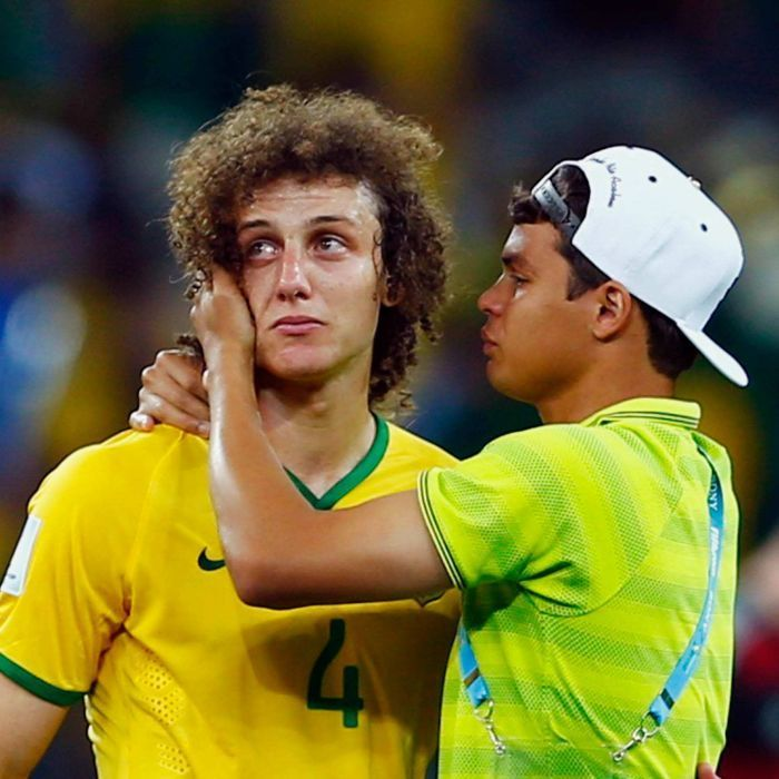 David Luiz and Thiago Silva - Brazil's David Luiz (L) is consoled by teammate Thiago Silva after their 7-1 loss to Germany in the 2014 World Cup semi-final in Belo Horizonte on July 8, 2014.