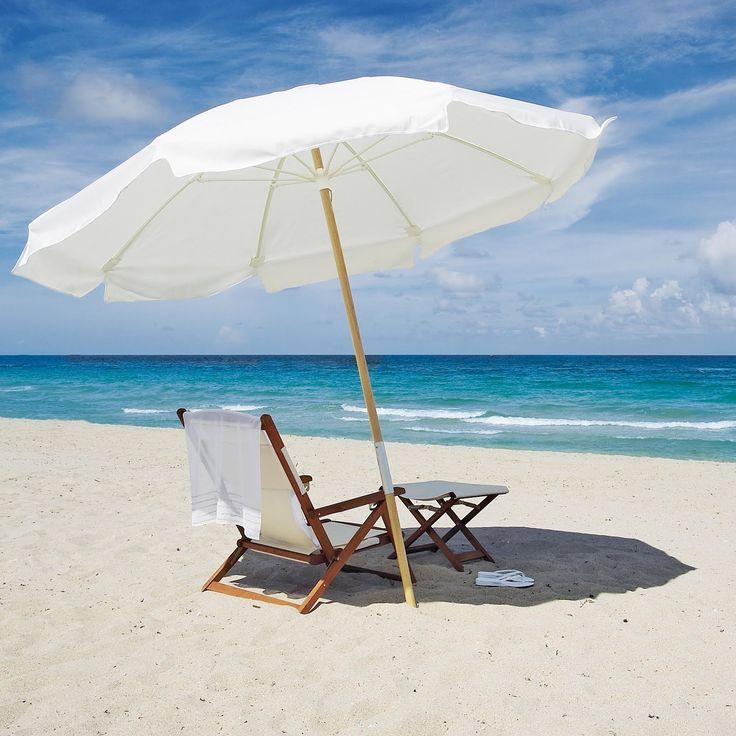 All White Umbrella Towel Chair And Sand Beach