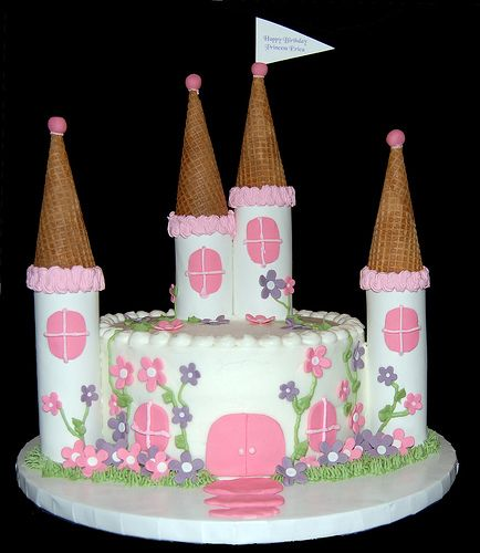 This cake was made for a little girl who is celebrating her first birthday. Its a smaller version of the Princess Olivia Princess Castle Cak...