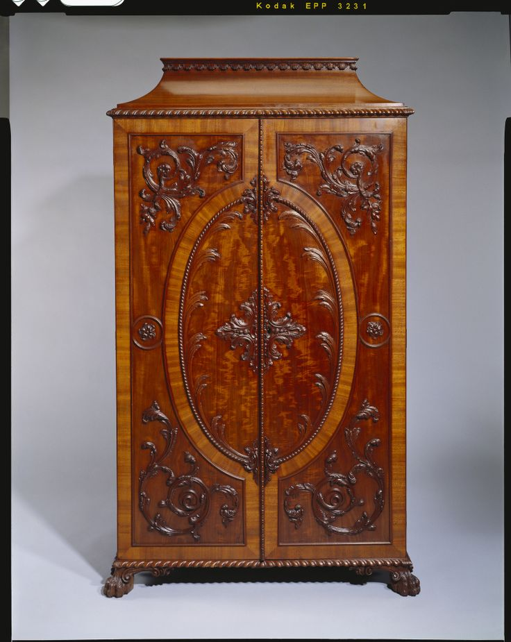 The Royal Collection: Cabinet   Made by Wiliam Vile in the year 1763 for the Gallery of Kensington Palace at the command of Queen Charlotte; in Queen Victoria's reign seven of the cabinets were brought back to Buckingham Palace; two were still at Windsor c.1905; finally in Queen Mary's time they were all reunited at Buckingham Palac