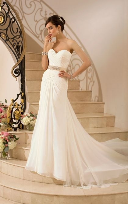 Stella York 5917   Purely cinematic, this elegant and unique wedding dress in Capri Chiffon features crisscross pleating throughout the fitted bodice and drop waist that cascades into a flowy skirt and court train