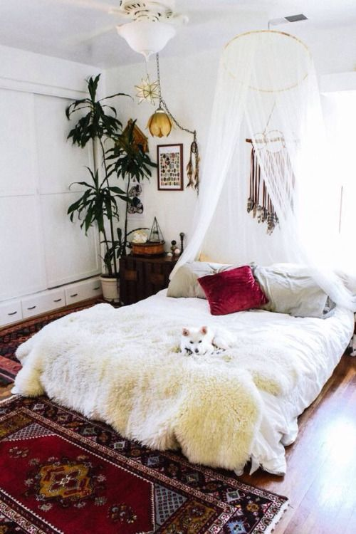 White walls and bedding, fur, plants and pops of colour with cushion and rug :)