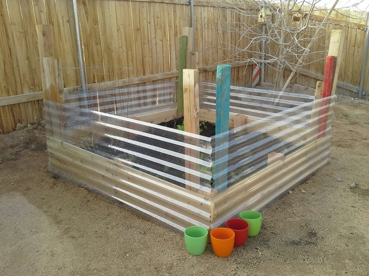 Acrylic siding for raised garden bed. Wind protection for young plants, and those pesky little ground squirrels are good, but I don't think they are good enough to climb slick plastic... Win!