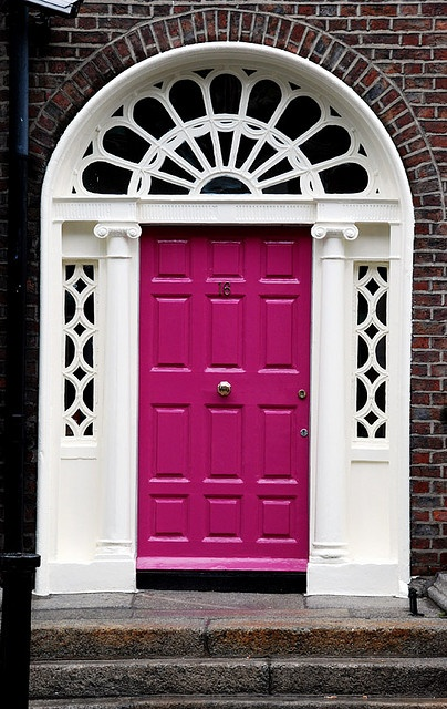 magenta! If only I could convince my husband to let me have a front door like this.