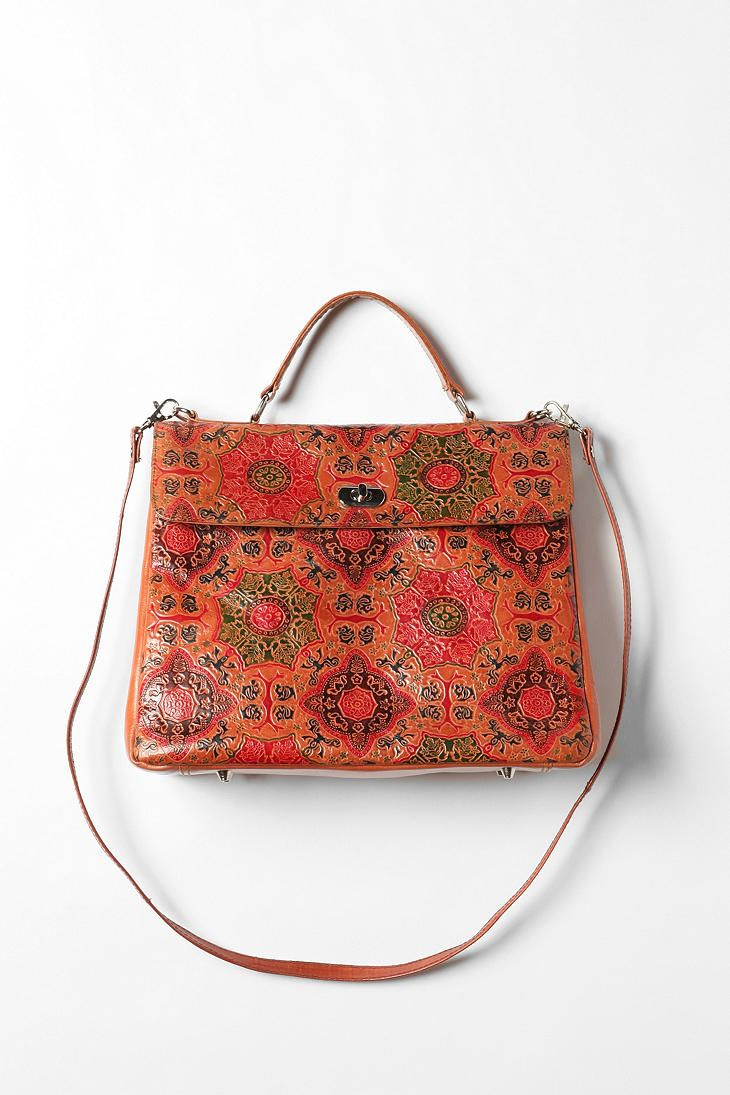 I wish this wasn't made of leather. (Try to avoid it where possible.) I quite like the intricate design. (Ecote Tooled Lady Bag, Urban Outfitters, $88)