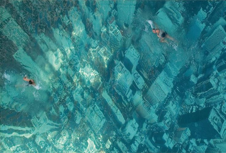 Swim over the N.Y.C?? :)  well, it's a  swimming pool and has been built to raise awareness about the threat of sea level rises as a result of global warming. It was constructed by attaching a giant aerial photograph of the New York City skyline to the floor of the pool. Mumbai,India.