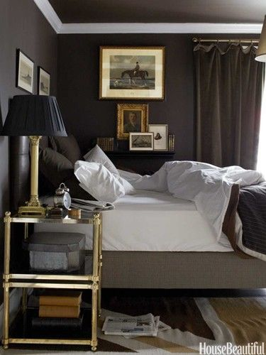 Wonderfully masculine bedroom...charcoal walls, crisp white sheets, brass and glass night tables, a cocoon of a room to sleep in!
