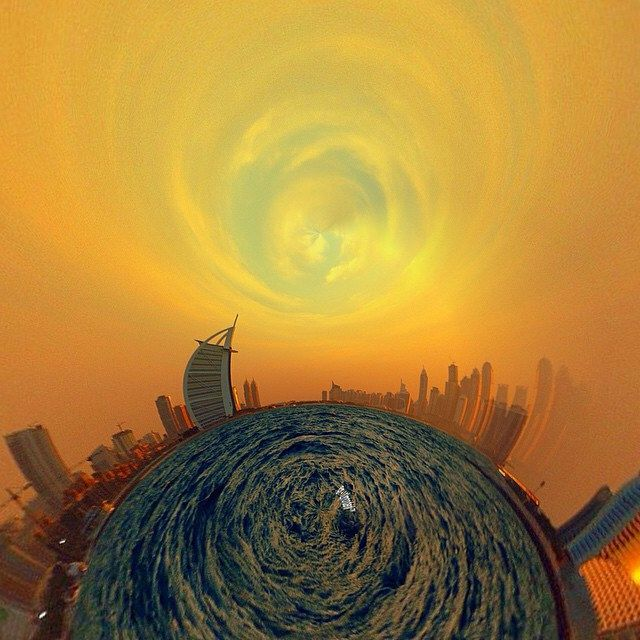 @burjalarab #rollworld @RollWorldApp, #TinyPlanet #PhotoSphere #StereoGraphic #RollWorldApp #MyDubai #iphoneography #Canon #EOS650D #gold #skyscrapers #skyandsea #photooftheday