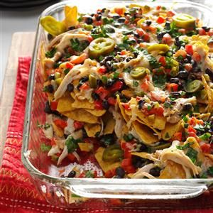 Baked Chicken Nachos Recipe -Here's a party appetizer that's delicious and so simple. Rotisserie (or leftover) chicken keeps it quick, and the seasonings and splash of lime juice lend fantastic flavor. My husband likes this snack so much that he often requests it for dinner! —Gail Cawsey, Geneseo, Illinois