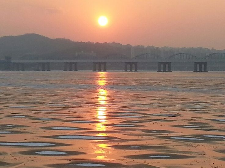 Sun sets on icy Han River