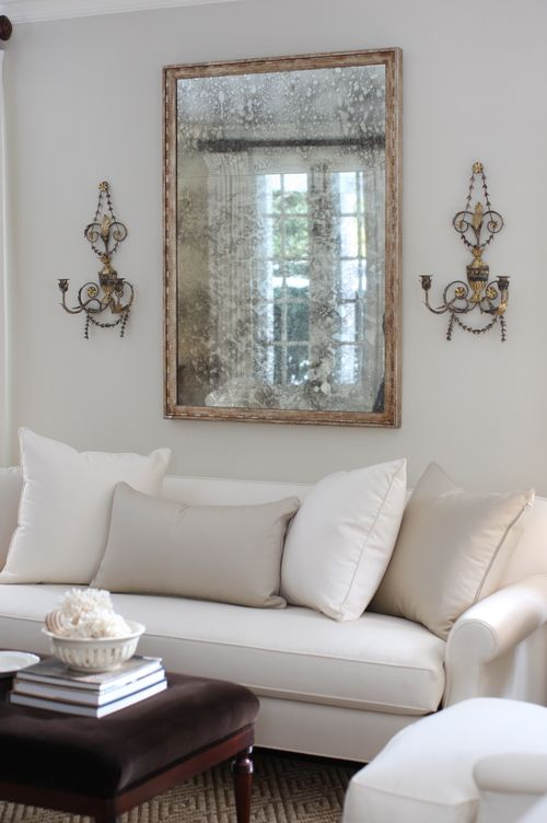 Best White On White Is Such A Soothing Look For A Living Room Love The Antique Mirror And Sconces 400 x 300