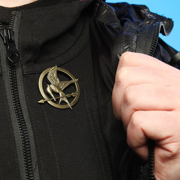 A Token from Your District; A Symbol of the Rebellion Officially-licensed Hunger Games merchandise! Prop-replica brooch with easy-functioning pin back. Deemed unusable as a weapon. Read more... $11.99