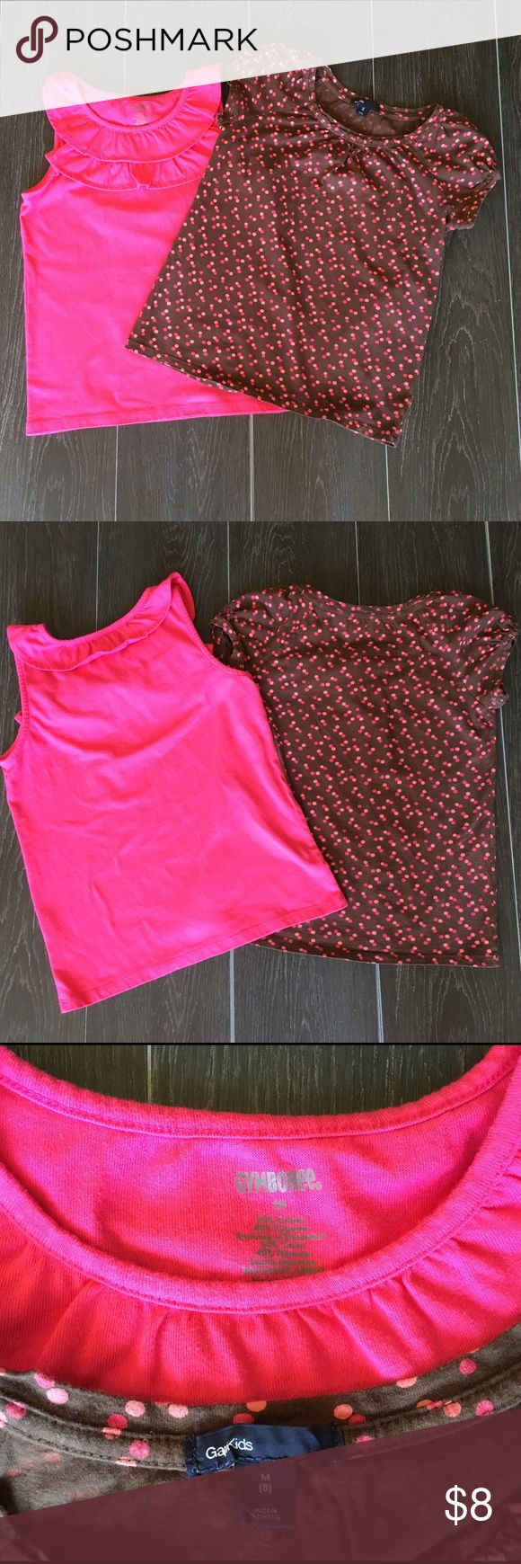 Gap and Gymboree Girls Shirts Gap and Gymboree Girls short sleeve shirts size 8.  Gymboree shirt is a pink tank with ruffles on top and labeled 10, but runs small and fits at an 8.  Gap shirt is short sleeves with pink polka dots size 8.  Super cute!  Small snag in the gap shirt on back (pictured).  Really not noticeable, other than that both pieces are in great used condition!  Smoke and pet free home!  20% off all bundles! Shirts & Tops