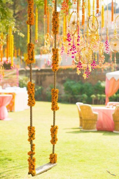 Marigold decor , yellow flowers, hanging wheel decor ,