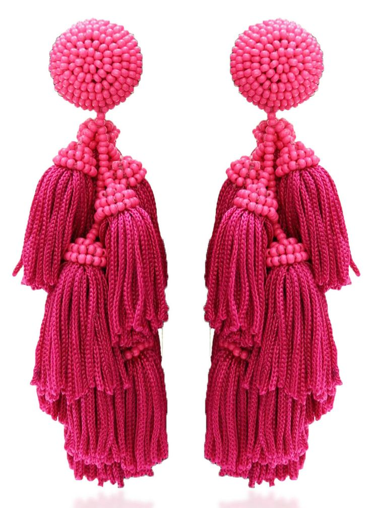 Pink tassel statement earrings - 5 jewelry trends for 2017 2018 (and where to buy) http://www.boomerinas.com/2017/02/24/big-statement-earrings-5-trendy-styles-for-women-over-50-with-fat-faces/