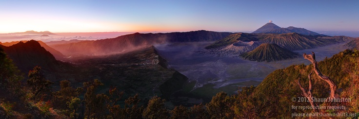 Dawn breaks over the Tengger Caldera as a dust storm rolls in and Semeru puts on a show, venting a small eruption into the morning air.