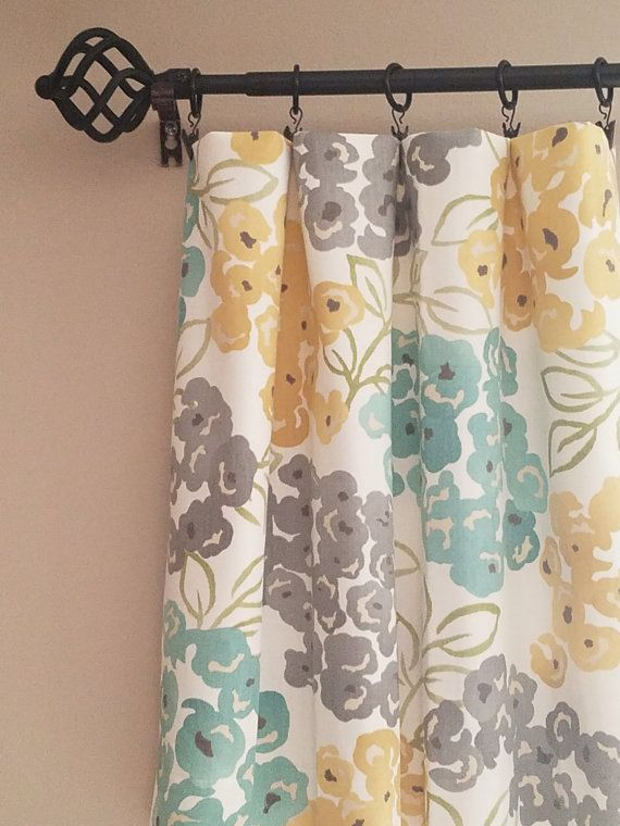 Free pillow cover with every pair of panels ordered! Pair of Teal, yellow and gray drapery curtain panels.