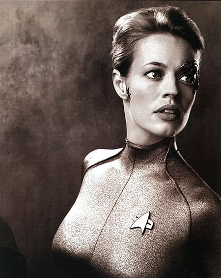 """trekcore: """"Jeri Ryan as Seven of Nine - and unless I'm seeing things, looks like a Starfleet uniform shoulder at the bottom left? So someone else was in the photo but cropped out. Perhaps? """""""