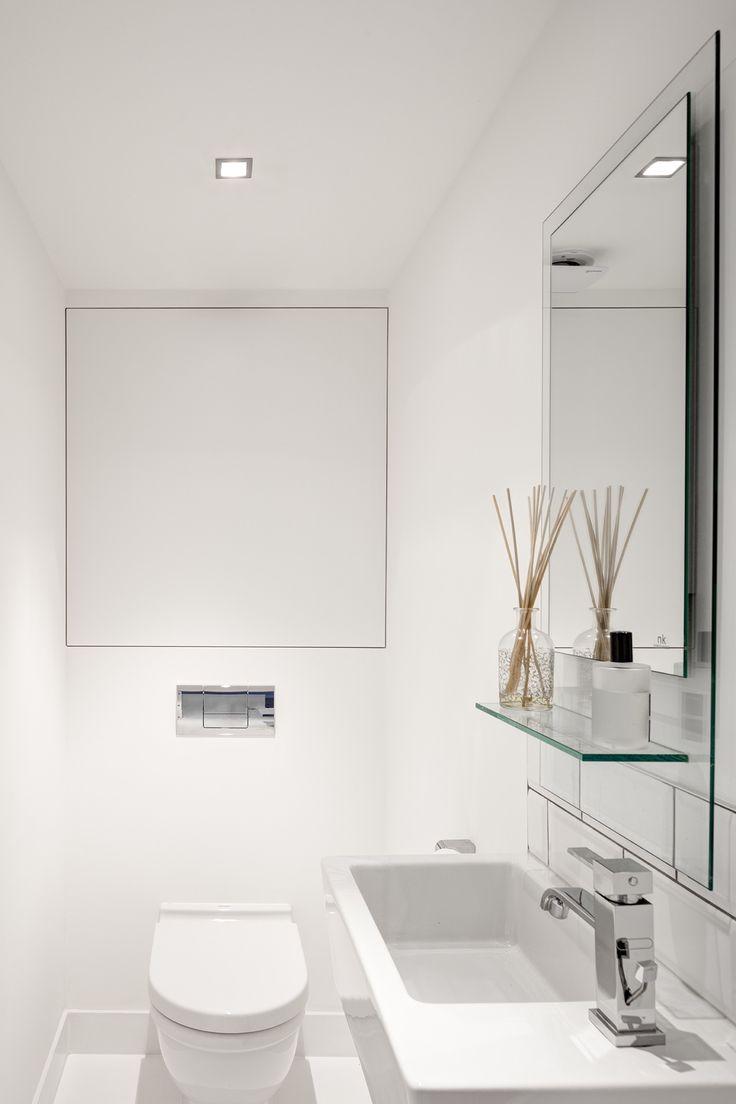 White on white tiny bathroom