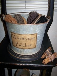 Love this old bucket with old brushes