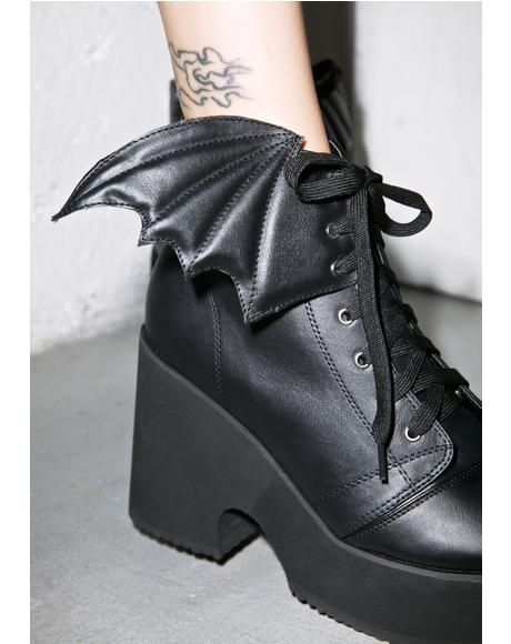"Iron Fist Bat Wing Platform Boots cuz ya stay fly with yer fellow battie babes, these amazing boots are constructed outta super soft N' smooth vegan leather with epic 3D perforated bat wing details at yer ankles. Featuring interior zippers, front laces, 4"" heels and 2.5"" platforms to stop 'round in."