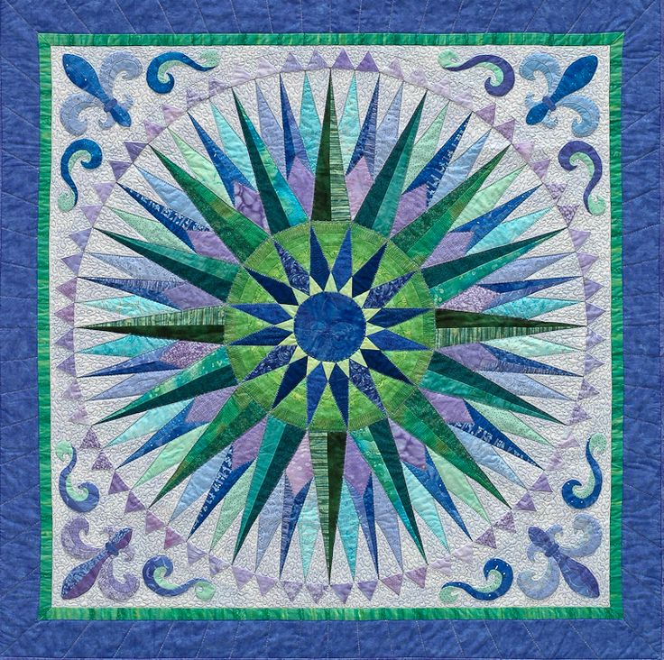 Value Play creates Beautiful Effects:  In Lois Dunten's original mariner's compass design, she features middle value hues.  Joen Wolfrom  has a new online color class, Color Play for Quilters, at Craftsy, if you are interested in learning more about color.