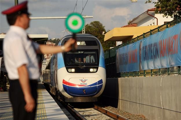 The first Turkish high-speed train arrives at Pendik railway station, in Istanbul, during the high-speed train opening cerenomy on July 25. ...