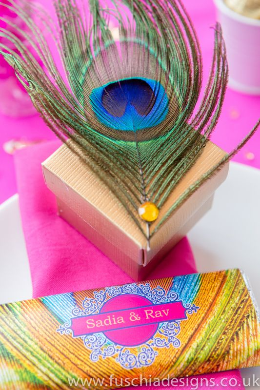Stunning Asian wedding favours inspired by the peacock. Gold favour boxes hand decorated with peacock feathers and a gemstone for that special Asian touch.  A Fuschia favourite is the peacock chocolate bar favour which can be personalised with your names, date and a personal message.  These Asian peacock favours will certainly wow your guests at your wedding or celebration.  From www.fuschiadesigns.co.uk