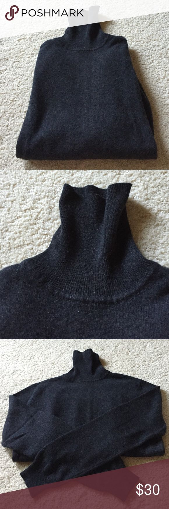 "Country Shop Cashmere Sweater Excellent condition. 100% cashmere. Thick and soft. Long sleeves, turtleneck. Dark gray. Banded sleeves and bottom edge. Not from a smoke free house. Dry clean only. 18.5"" armpit to armpit. 24"" long from shoulder. Country Shop Sweaters Cowl & Turtlenecks"