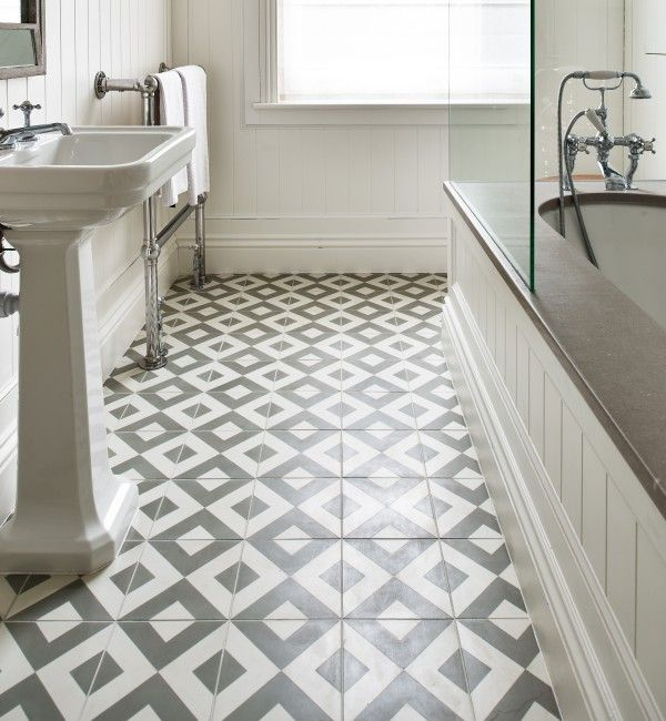 Modern Harlequin encaustic tiles from Ca' Pietra. Grey and white diamond pattern tiles.