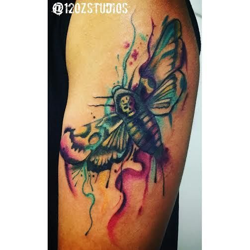 Awesome death's head moth tattoo done in a watercolor paint splatter style by Jose Bolorin.
