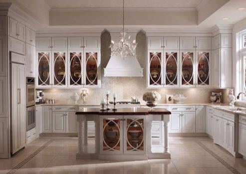 Kraftmaid kitchen hollywood regency cabinets with cream mosaic tile  backsplash! Love the tinted glass doors on the kitchen cabinets and island.