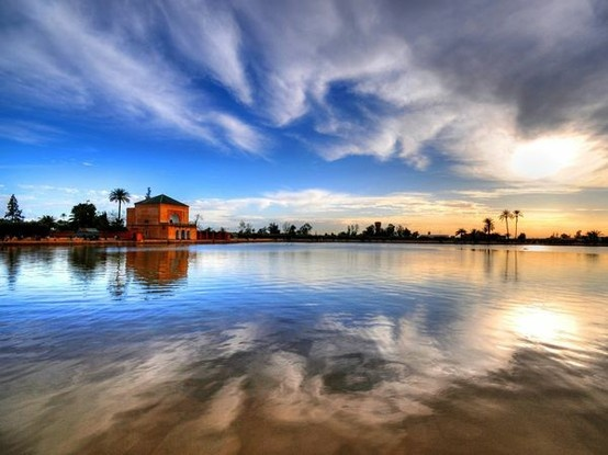 Menara Gardens Photograph by Sergio Amiti, My Shot  Sundown at Menara Gardens provides a tranquil escape from sprawling Marrakech to the east. Designed in the 12th century as a summer escape from the city heat, the gardens' palms and olive trees rely on this artificial lake for irrigation.