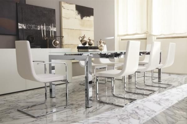 Airport, modern extending dining table with a white glass top and chrome legs by Calligaris