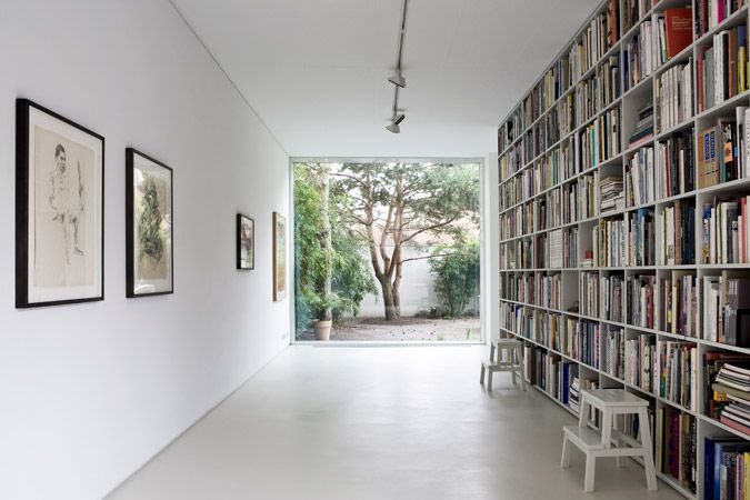 On the one hand it's crying out for a sofa, but on the other, I love the zen of it - art on one wall and books on the other framing the garden. Photo HELENIO BARBETTA